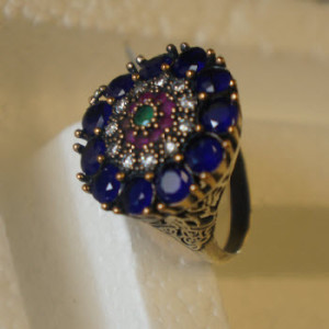 Silver sapphire and ruby ring
